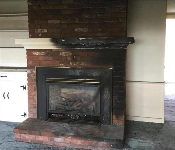 charred and burnt fireplace mantle and soot